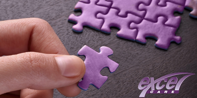 Hand holding a piece of blank puzzle